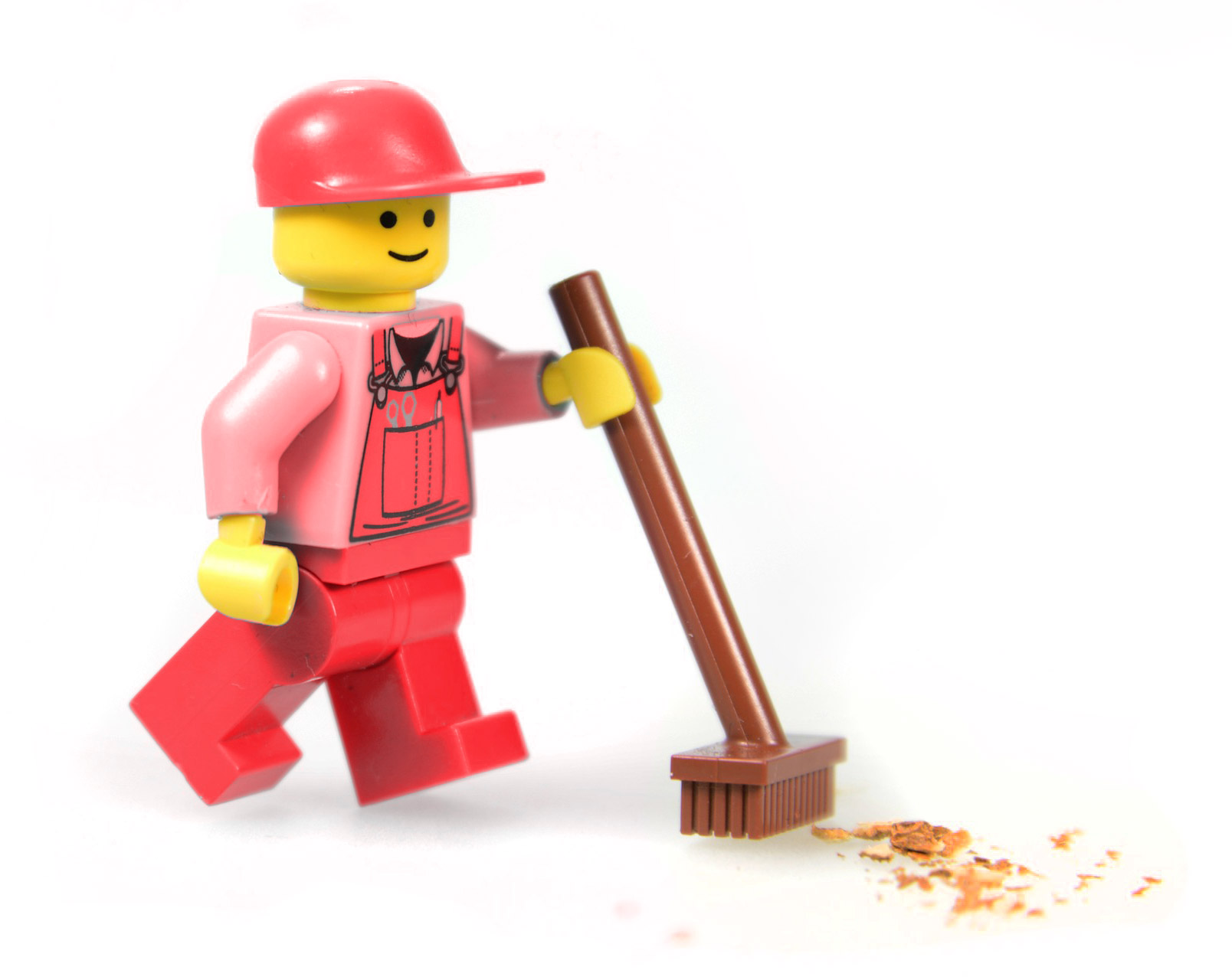 Lego man cleaning with a lego broom
